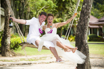 happy couple get married on the beach in Thailand