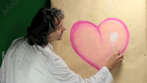 artist at work on heart sketch