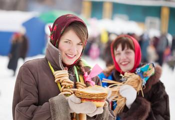 girls  with pancake during  Shrovetide