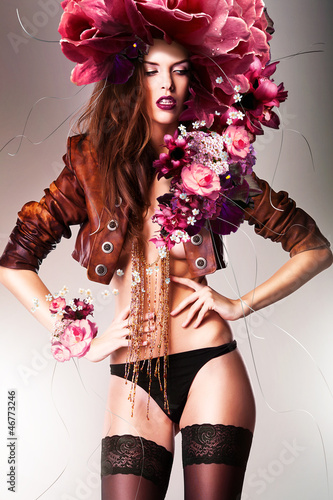 pretty gorgeous erotic woman in brown jacket and flowers