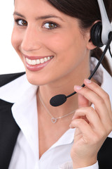 Brunette receptionist wearing head-set