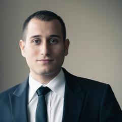 Portrait of young happy businessman.