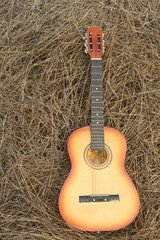 guitar on the hay