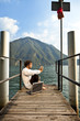 portrait of young man on the pier of Lake in Lugano