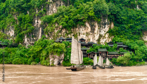 Chinese village and a boat on the Yangtze River in the mountains