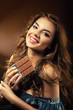 smiling woman and chocolate bar
