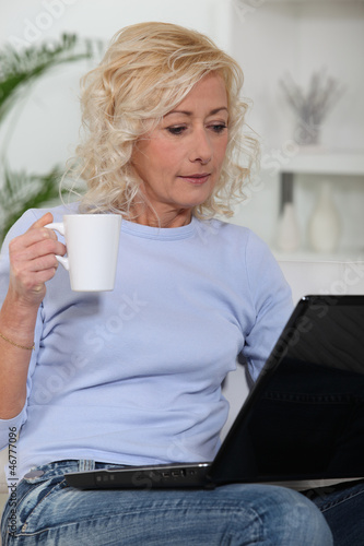 Woman at computer with coffee cup