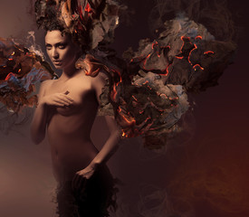 erotic nude woman in dark burning paper