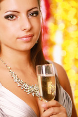 Young beautiful woman with champagne glass