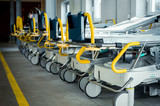 Row of empty beds in hospital corridor