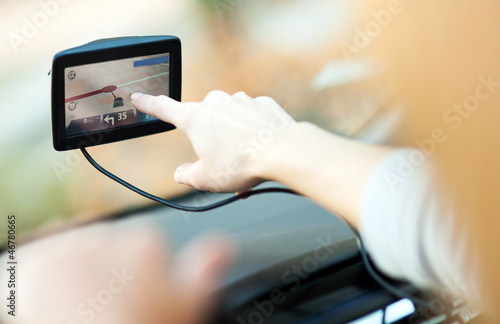 Woman using GPS in car