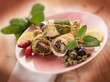 swordfish stuffed with capers olives and sage, selective focus