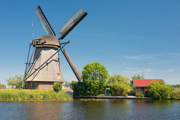 Windmill at Kinderdijk in a sunny spring day