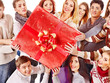Group people holding gift box.