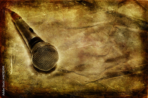 Grunge music background with dynamic microphone