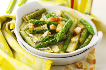Asparagus baked with cheese and lemon peel.