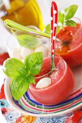 Delicious cold gazpacho soup with mozzarella and basil.