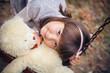 Small beautiful girl and amusing bear