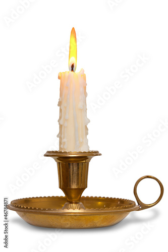 Candle in brass chamberstick holder isolated
