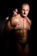 Woman hugging muscular man