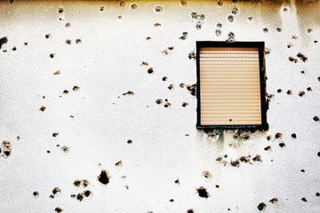 Bullet holes in a house facade