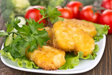 appetizing chicken nuggets with lettuce leaves