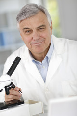 Portrait of senior doctor in biology working in laboratory