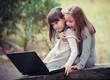 girlfriend in autumn park with laptop