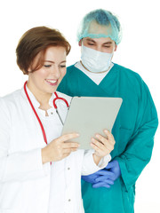 Team of doctors, surgical team with touchpad