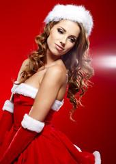 Christmas Santa hat  woman portrait hold christmas gift.
