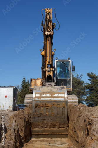 excavators digging sewer trench