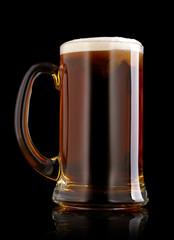 Mug of beer over black background