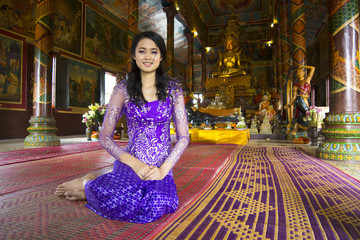 Asian girl praying in temple