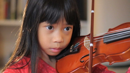 Six Year Old Asian Girl Practices Her Violin-Close Up