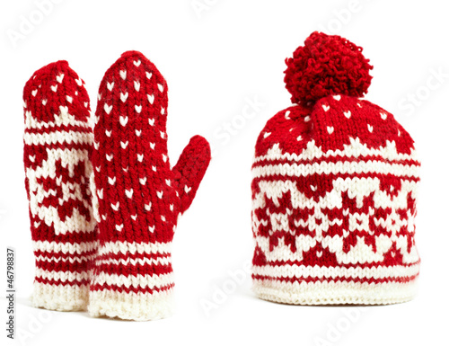winter cap and mittens knitted with jacquard motifs, isolated
