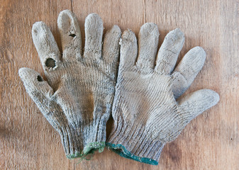 old gloves on wood background