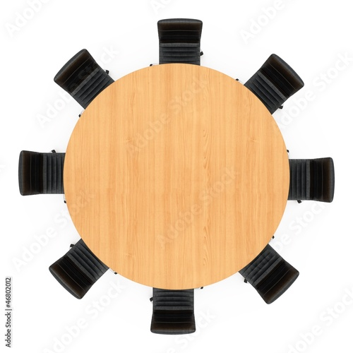 chairs around a round wooden table