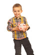 Happy boy holding piggybank