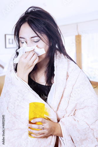 Blowing nose while hold glass and tissue at home
