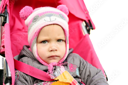 serious girl in stroller