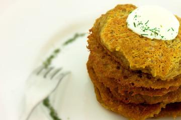 Homemade potato pancakes isolated on white plate
