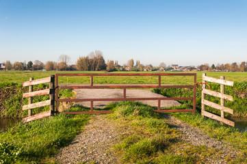 Closeup of a fence in a Dutch polder landscape