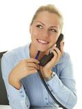 Beautiful secretary has a good call at work