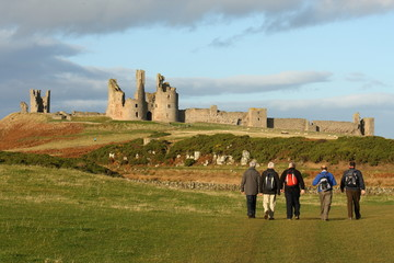 group of pensioners visiting Dunstanburgh castle