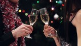 couple toast with wine glasses at christmas party