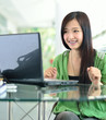 Asian girl smiling in success job