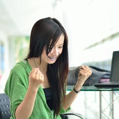 Asian girl smiling in success job