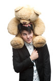 businessman with big soft toy on shoulders