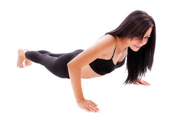 Hispanic woman doing pushups isolated on white background