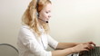 Pretty smiling customer service worker at call center